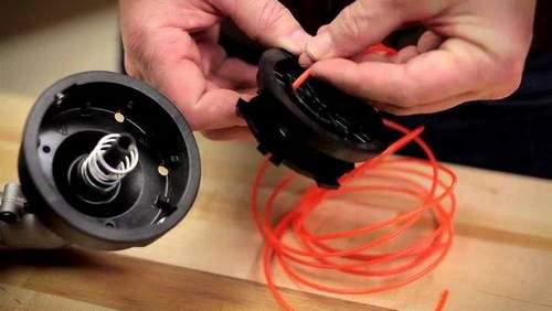 How to Change a Fishing Line on a Champion Lawnmower Video