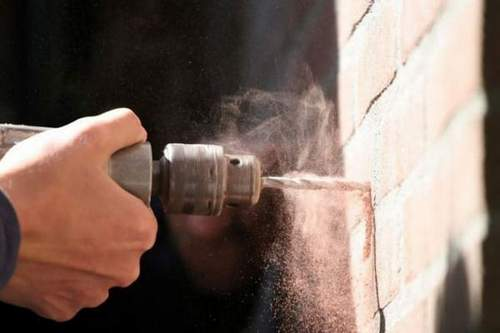 How to Make a Hole In Concrete Without a Puncher